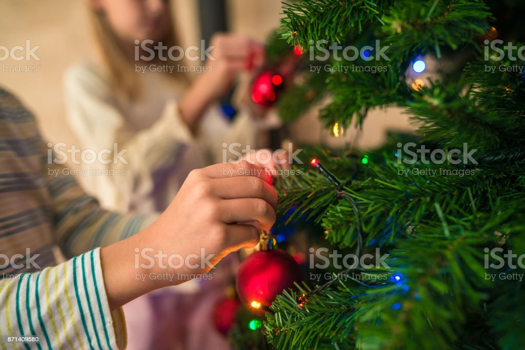 The kids love to decorate the Christmas tree stock photo