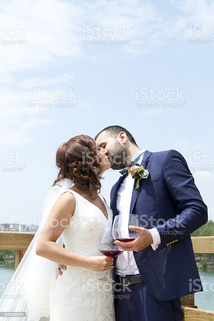 The Kiss - Bride and groom stock photo