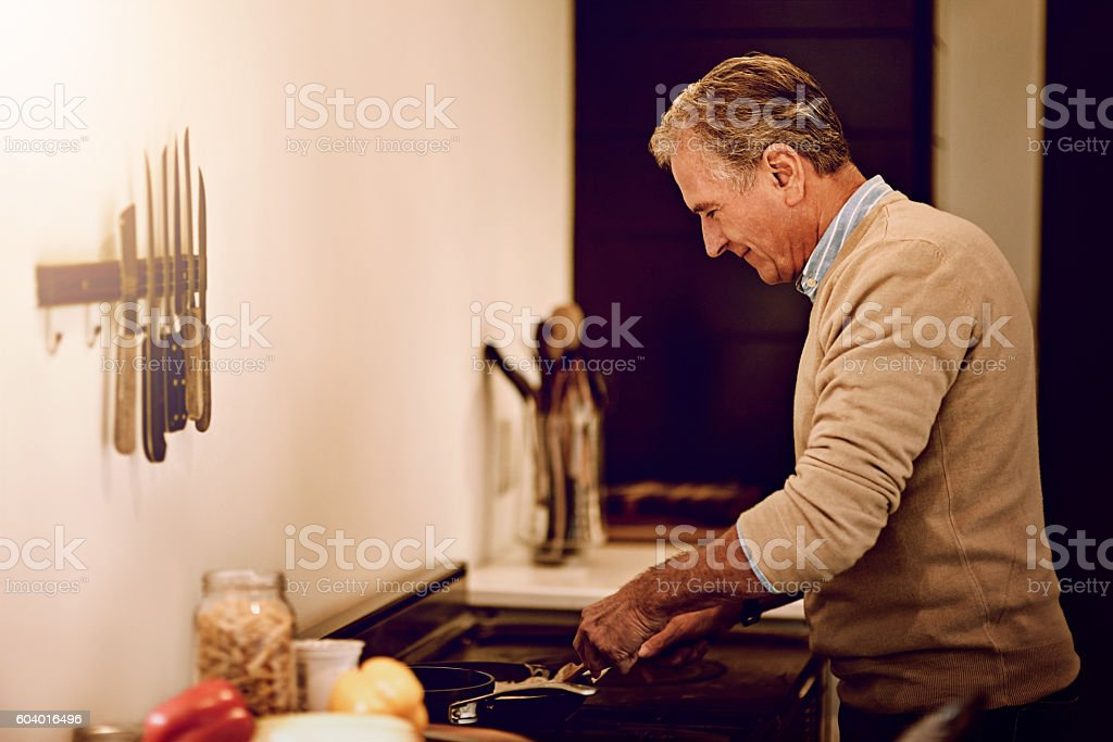 The kitchen is his happy place stock photo
