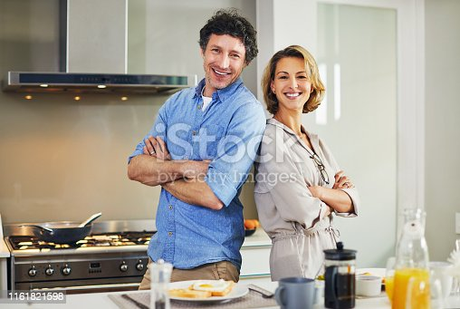 Portrait of a confident mature couple preparing breakfast together at home