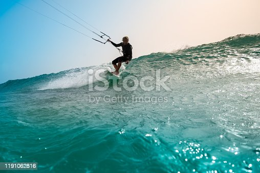 The kite surfer rides the waves of the Atlantic Ocean on the Fuerteventura island, Canary Islands