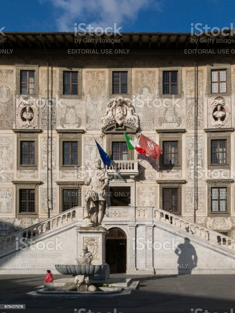 The Knights Square ( Piazza dei Cavalieri ) with Palazzo della Carovana and statue of Cosimo I de' Medici in the center of old town in Pisa, Italy royalty-free stock photo