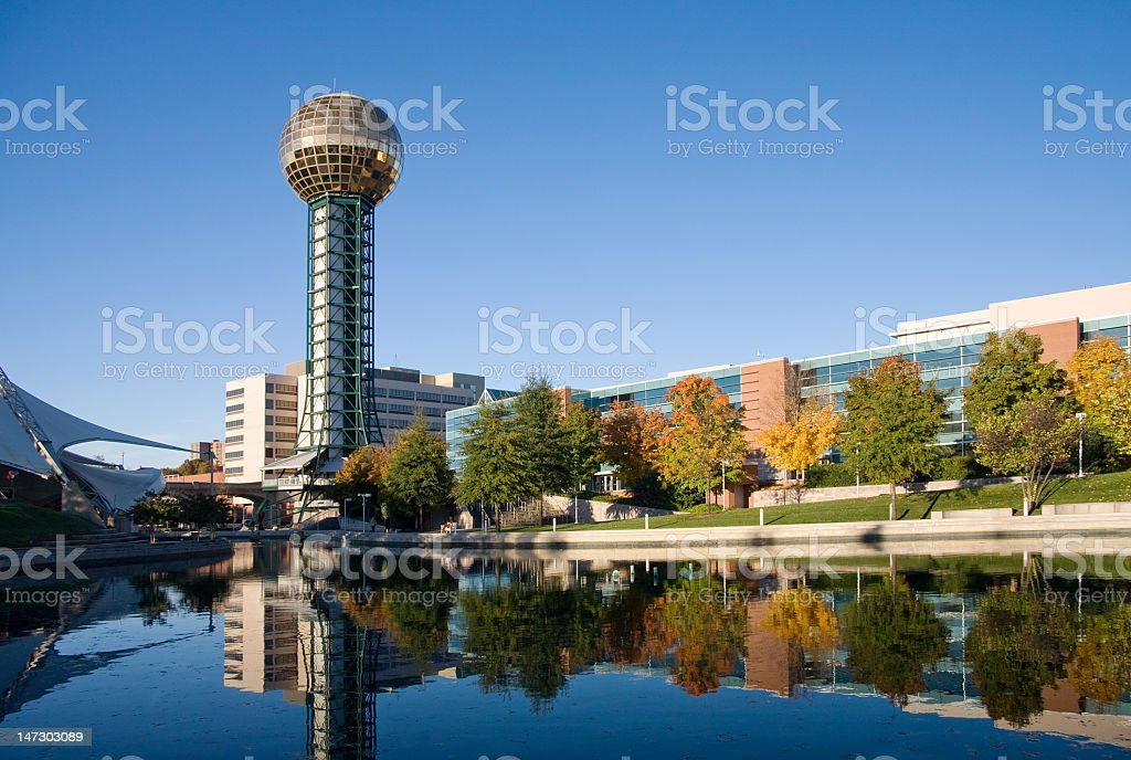 The Knoxville sun sphere reflecting in a lake stock photo