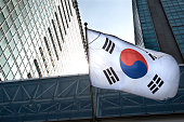 The Korean flag hanging in a high-rise building