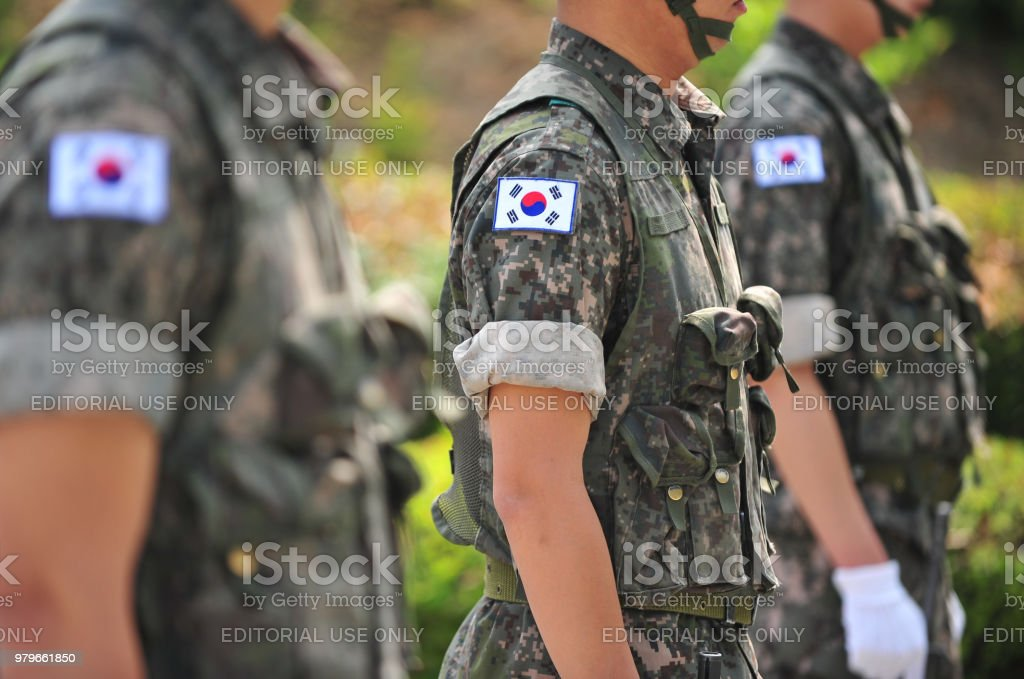 The Korean national flags attached to Korean army uniforms stock photo
