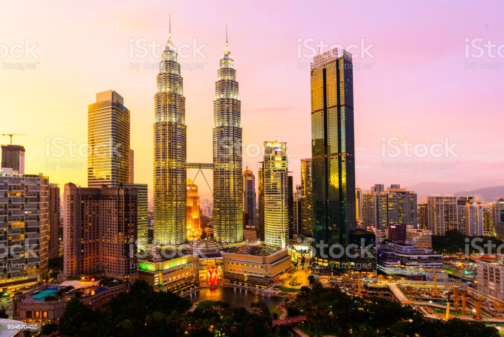 The Kuala Lumpur City Skyline With the Petronas Towers Illuminated at Sunset, Malaysia. stock photo