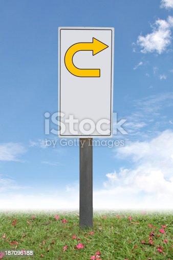 The Label indicates of U-turn on blue sky.