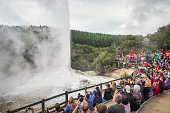 Wai-O-Tapu Geothermal Park, Rotorua, New Zealand - Mar 26, 2016. The Tourists are Watching the Lady Knox Geyser erupting.