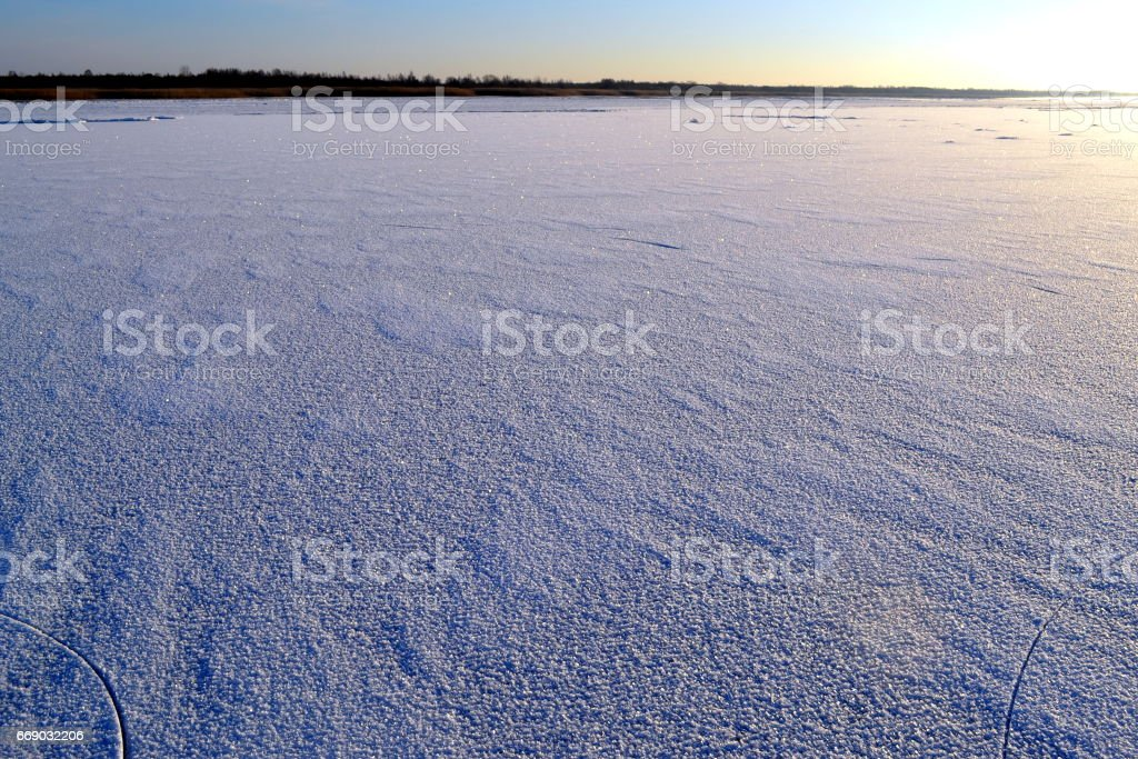 The lake is covered with ice. Winter sunny frosty day. stock photo