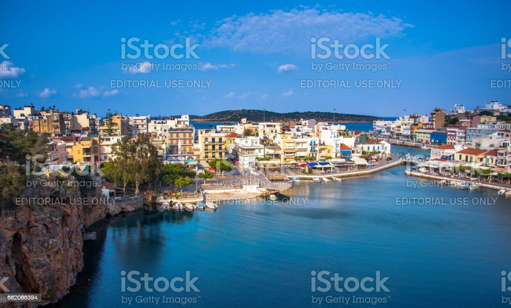 The lake Voulismeni in Agios Nikolaos,  a picturesque coastal town with colorful buildings around the port in the eastern part of the island Crete, Greece royalty-free stock photo