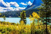 Glacial Lake Louise in Banff, Canadian Rockies. The lake with azure water is surrounded by mountains and forests. Beautiful fine day. The concept of ecological, active and photo tourism
