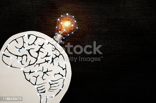 1007367156 istock photo The lamp represents creativity, the brain image is made by cutting method. 1188433474