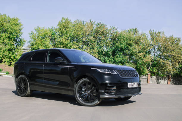 The Land Rover Range Rover Velar in Black color compact luxury crossover SUV Moscow, Russia - September 14, 2018: in the industrial zone The Land Rover Range Rover Velar in Black color compact luxury crossover SUV range rover stock pictures, royalty-free photos & images