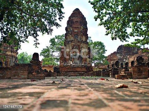 The old buddha statue and ruin of pagaoda at Wat Mahathat in Ayutthaya, Thailand