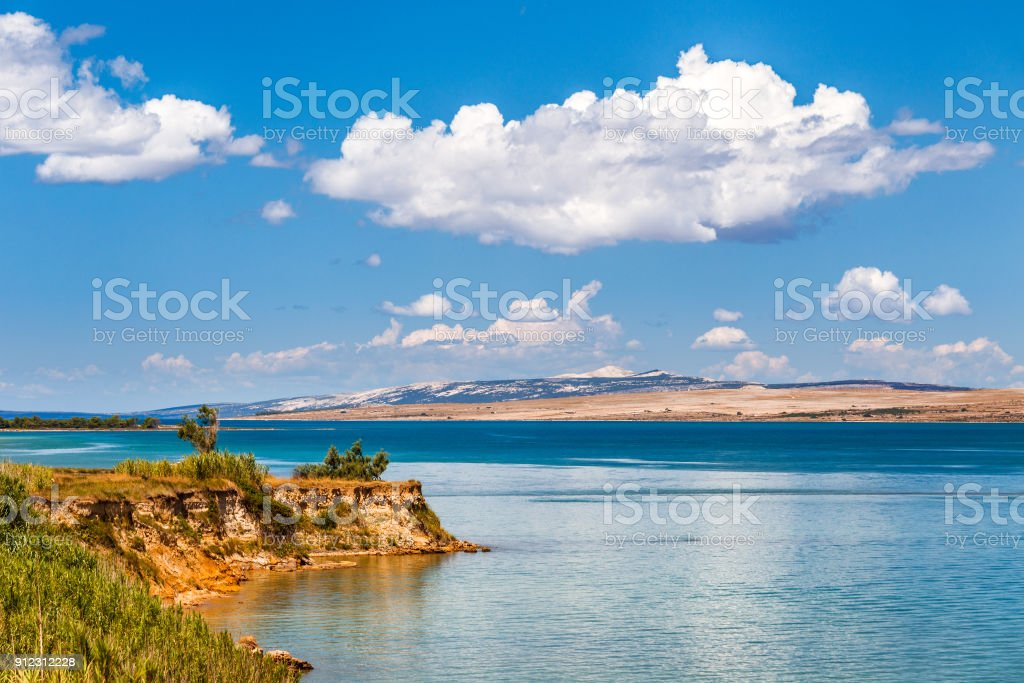 The landscape with sea bay and with the island of Pag. stock photo