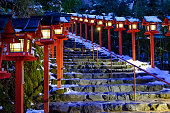The lantern-lined steps in winter snow in Kibune at night
