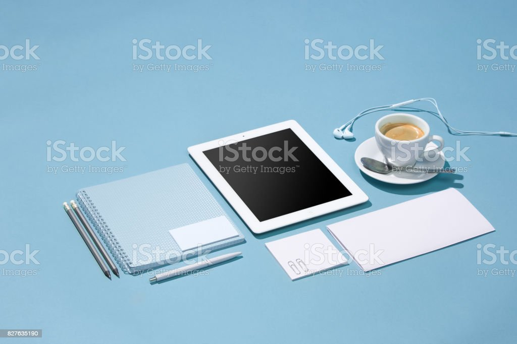 The laptop, pens, phone, note with blank screen on table stock photo
