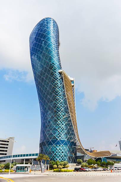 the large blue capital gate tower - abu dhabi stok fotoğraflar ve resimler