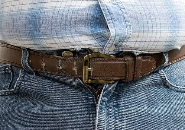 The Last HOL(P)E The Last Hole on the Belt - The Last Hope after Lunch men in tight jeans stock pictures, royalty-free photos & images