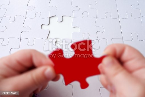 istock The last puzzle piece of a Jigsaw puzzle 869899412