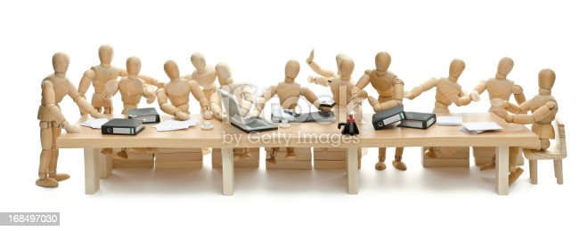 the last supper - ops, the last meeting - of wooden mannequin. Hommage to Leonardo da Vinci.