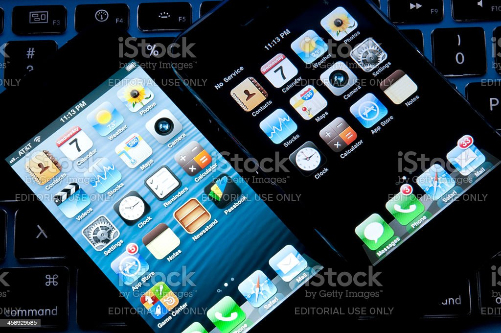 The latest Apple Iphone 5 next to 3G model royalty-free stock photo