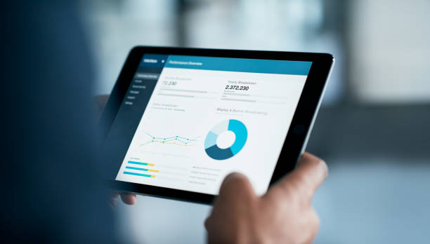 The latest business reports are in Closeup shot of a businessman analyzing statistics on a digital tablet in an office ipad stock pictures, royalty-free photos & images