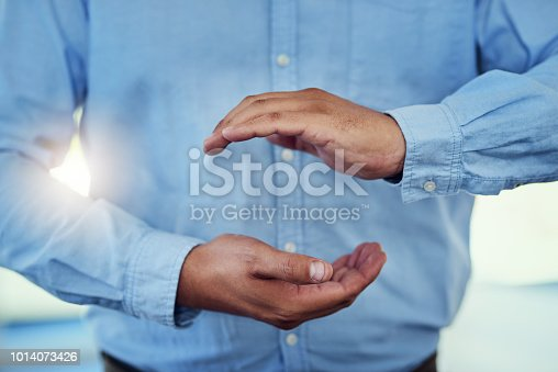 Cropped shot of a businessman making a gesture with cupped hands