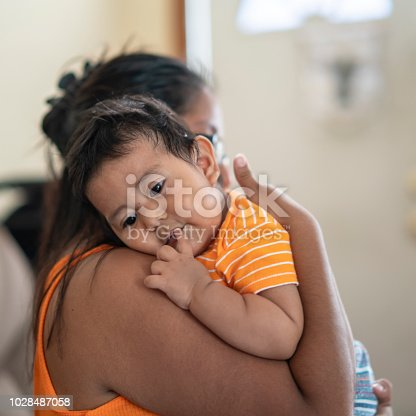 The Latino Mexican-American mother with son, a little boy, in his house in Pennsylvania, USA