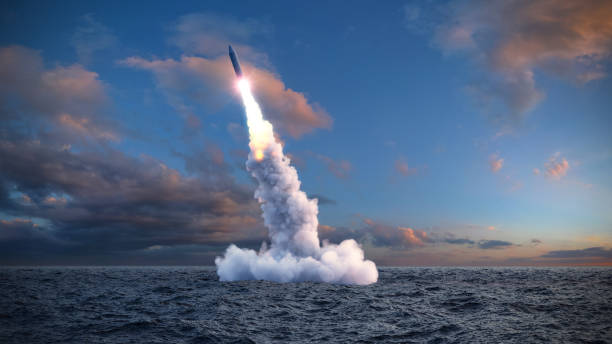 The launch of a ballistic missile launch of a ballistic missile from under water military attack stock pictures, royalty-free photos & images