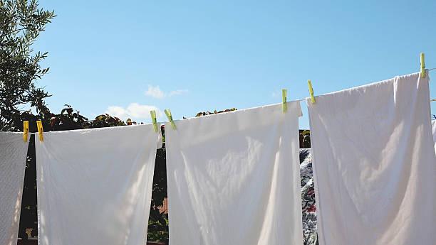 the laundry dries - horizontal gestreiften vorhängen stock-fotos und bilder