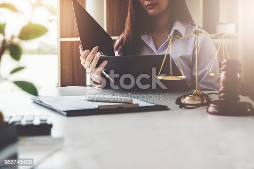 istock The law should know the concept, business entrepreneur woman, read the rules of business that her does business. 955745420