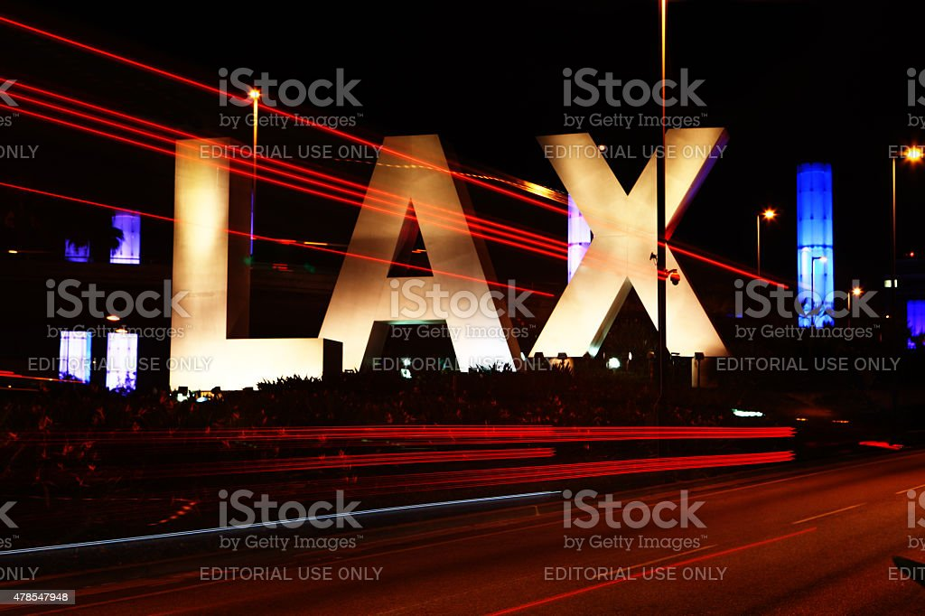 The LAX sign, Los Angeles airport during the night stock photo