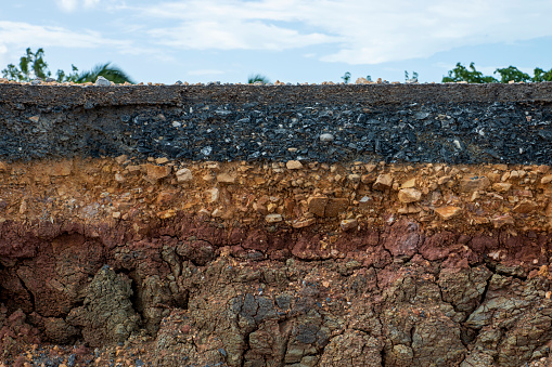 The layers of soil and rock of road.