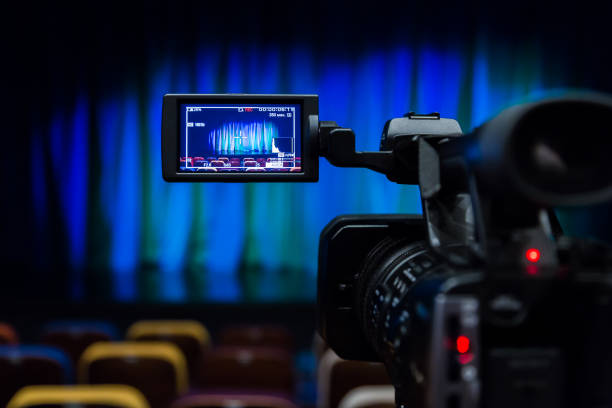 The LCD display on the camcorder. Shooting theatrical performances. The TV camera. Colorful chairs in the auditorium