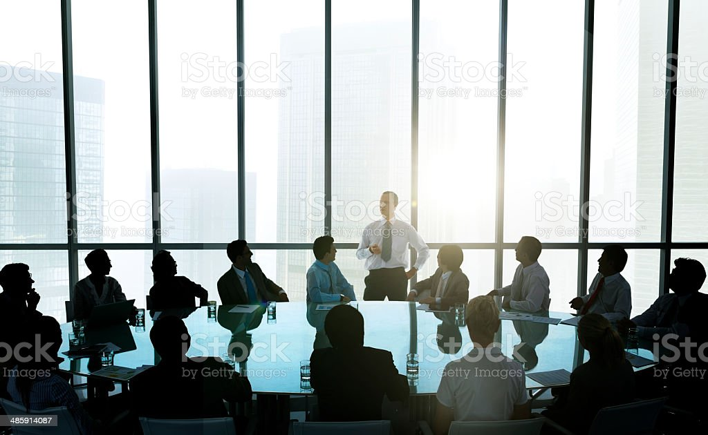 The Leader Of The Business People Giving A Speech The leader of the business people giving a speech in a conference room. Adulation Stock Photo