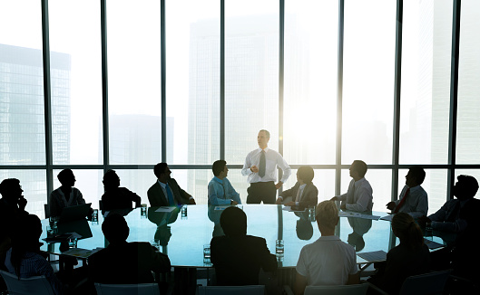 The Leader Of The Business People Giving A Speech Stock Photo - Download Image Now