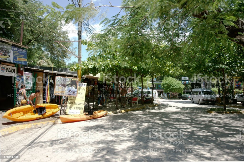 The leafy main street of Tamarindo, Costa Rica. stock photo