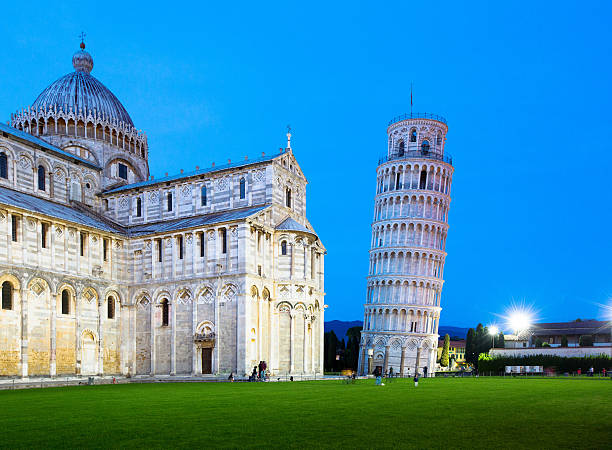 The Leaning Tower of Pisa and cathedral at dusk stock photo
