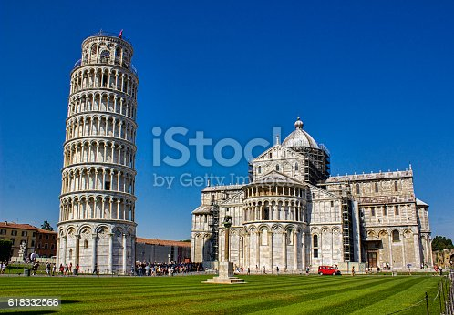 The Leaning Tower of Pisa -Torre pendente di Pisa-  It is located in Piazza dei Miracoli. It's also third oldest built structure in Pisa's Piazza dei Miracoli after Cathedral and the Baptistery. Horizontal composition. Front view.