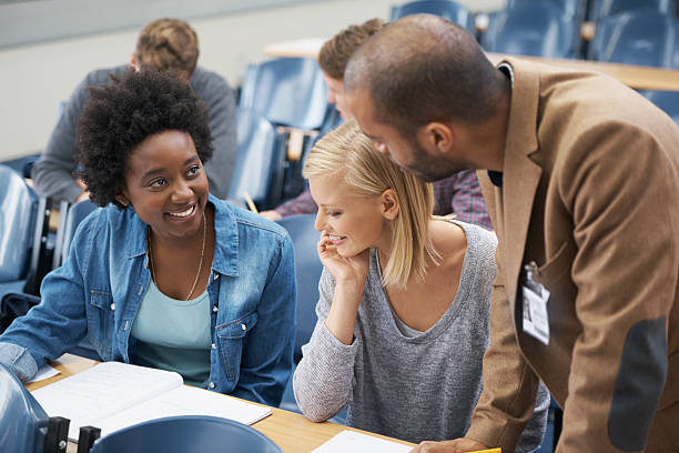 The lecturer is always on hand if you have questions stock photo