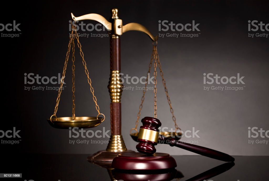 The legal hammer and the scale of justice on the table. stock photo