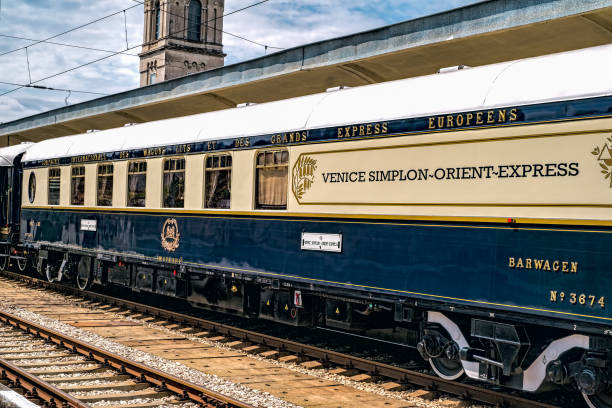 The legendary Venice Simplon Orient Express is ready to depart from Ruse Railway station in a cloudy day Ruse city, Bulgaria - August 29, 2017. The legendary Venice Simplon Orient Express is ready to depart from Ruse Railway station in a cloudy day. The luxury train travels between Paris and Istanbul. depart stock pictures, royalty-free photos & images