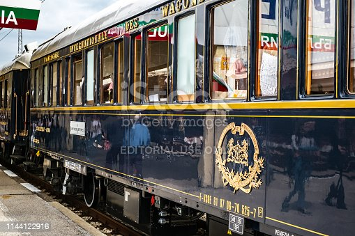 Ruse city, Bulgaria - August 29, 2017. The legendary Venice Simplon Orient Express is ready to depart from Ruse Railway station in a cloudy day. The luxury train travels between Paris and Istanbul.
