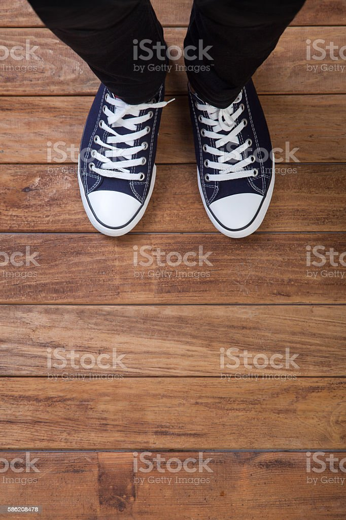 The legs of a man standing on wooden floor – Foto