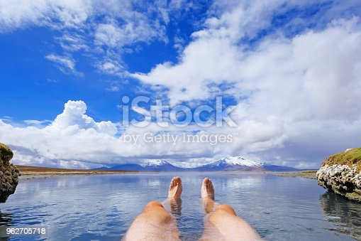 istock The legs of an athletic man in natural thermal hot spring Polloquere, Salar De Surire salt lake, Isluga Volcano National Park, Chile 962705718