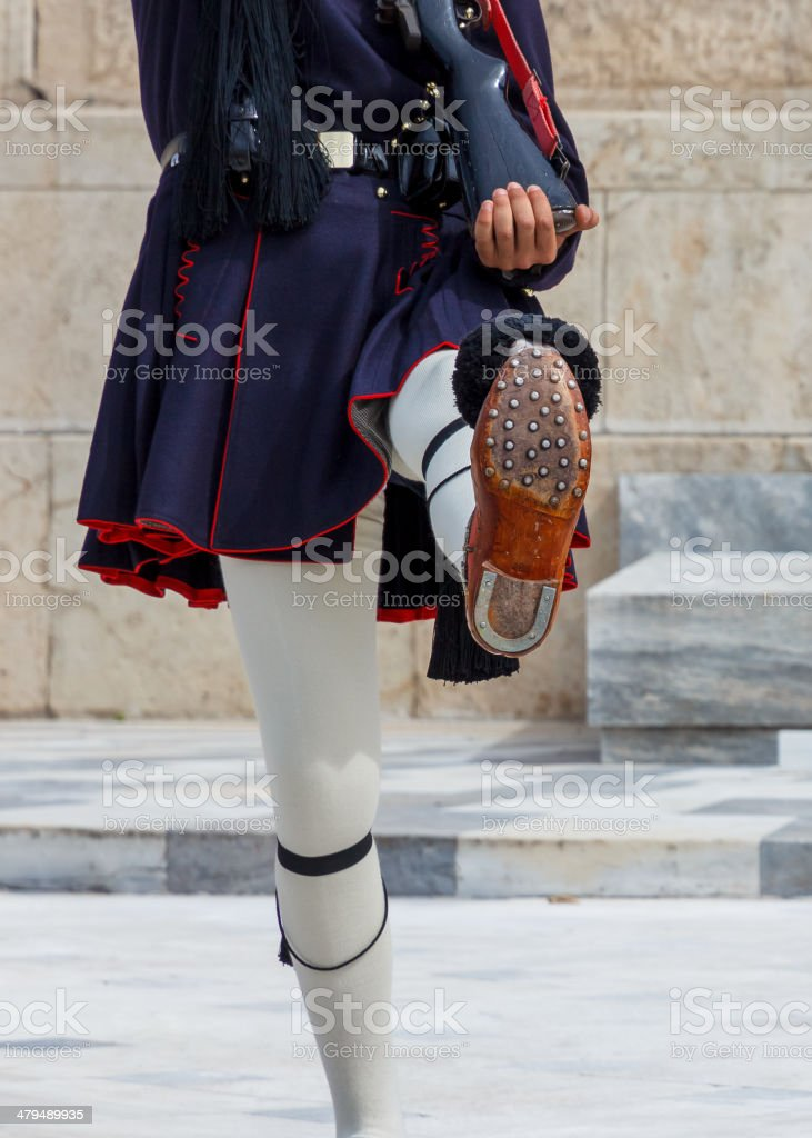 The legs of an Evzone in Athens, Greece stock photo
