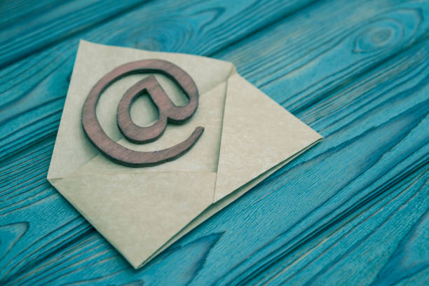 the letter, sign the e-mail on a wooden background the letter, sign the e-mail on a wooden background.  correspondence. newsletter stock pictures, royalty-free photos & images