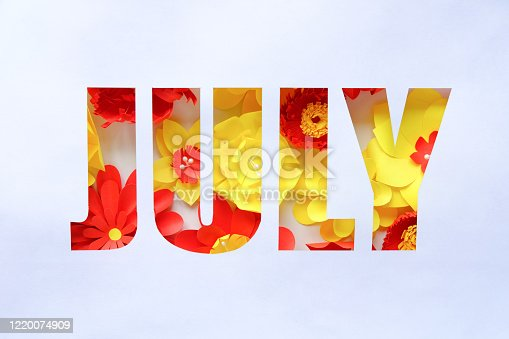 The lettering july, made of paper flowers. Hello, july. Concept of flowering, summer on white background