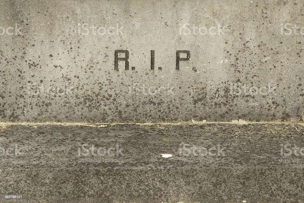 The letters RIP on an old grave stock photo